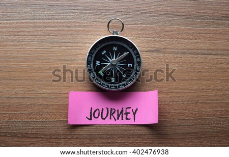 Journey : Motivation advice handwriting on label with compass - stock photo