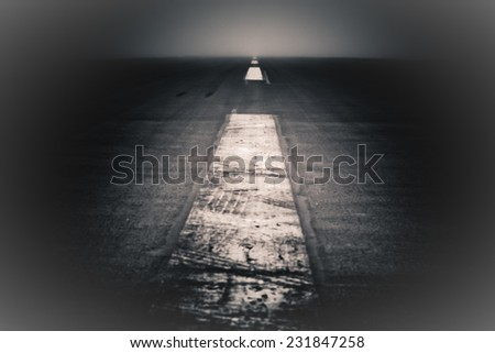 Journey to nowhere. Abstract creative photo of a dramatic dark road and sky. - stock photo