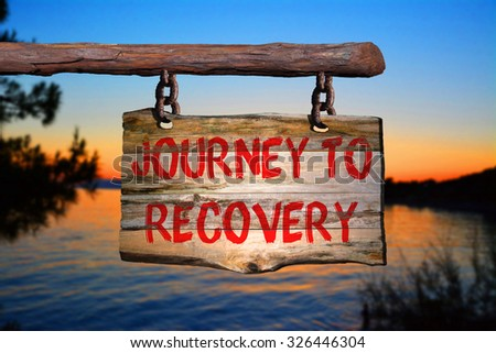 Journey to recovery sign with blurred background - stock photo