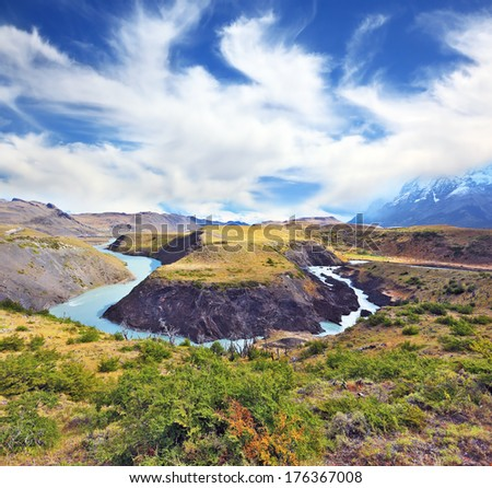 Journey to the End of the World. Incomparable beauty national park Torres del Paine in southern Chile. Above the valley flying flock of Andean condors - stock photo