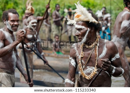 JOW VILLAGE, ASMAT DISTRICT, IRIAN JAYA, NEW GUINEA, INDONESIA - JUNE 28: Group of Asmat with a traditional painting on a face. June 28, 2012 in Jow Village, Asmat, Irian Jaya province, Indonesia - stock photo