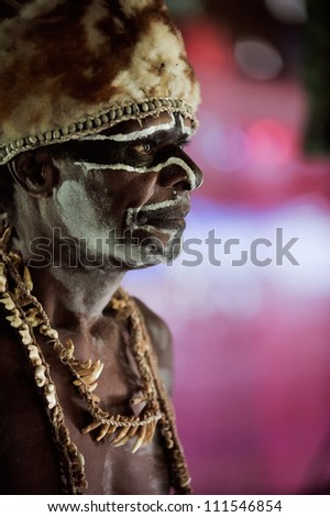 JOW VILLAGE, ASMAT PROVINCE, IRIAN JAYA, INDONESIA- JUNE 28: The Portrait Asmat warrior with a traditional painting and coloring on a face.  on June 28, 2012 in Jow Village, Asmat province, Indonesia - stock photo