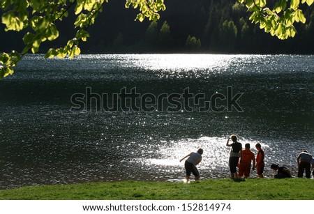 Joy at the lake-shore - stock photo