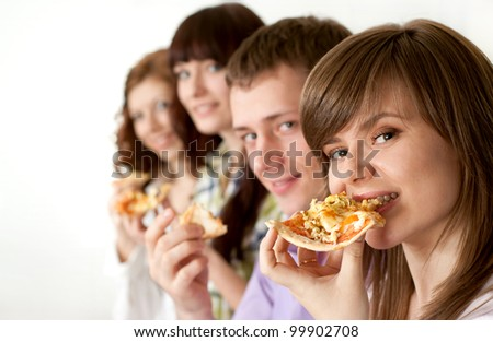 Joy funny Caucasian campaign of four people eating pizza on a light background