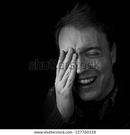 joy, man laughing black and white with copy space - stock photo
