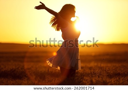 Joy. Teenage girl enjoy with sunshine in wheat field - stock photo
