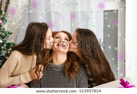 Joyful and happy daughter kissing her mother's cheek