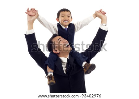Joyful Asian father giving piggyback ride to his son isolated over white background