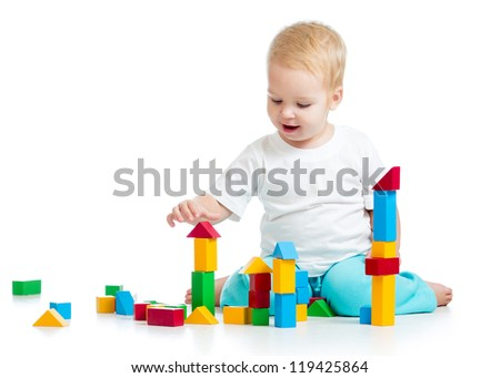 Joyful baby girl playing toy blocks  isolated on white background - stock photo