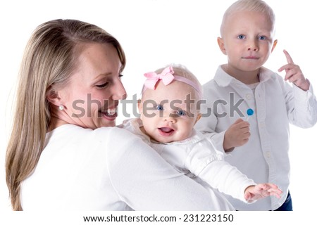 Joyful baby on hands at mother and boy with lollipop in hand