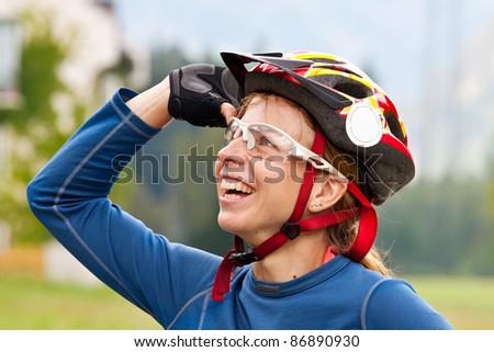 Joyful bikers portrait in mountains - stock photo