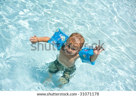 joyful boy in the pool