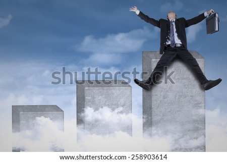 Joyful businessman celebrate his success while sitting on the highest chart at the sky - stock photo