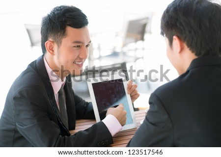 Joyful businessman presenting optimal business solutions to his partner