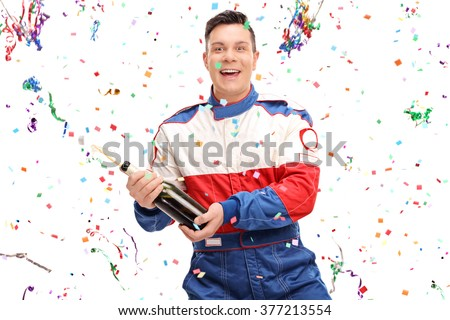 Joyful car racer celebrating victory with a champagne isolated on white background - stock photo