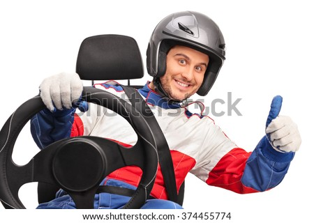 Joyful car racer holding a steering wheel and giving a thumb up isolated on white background - stock photo