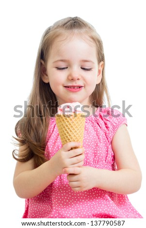 joyful child girl eating ice cream in studio isolated