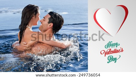 Joyful couple cuddling each other against cute valentines message - stock photo