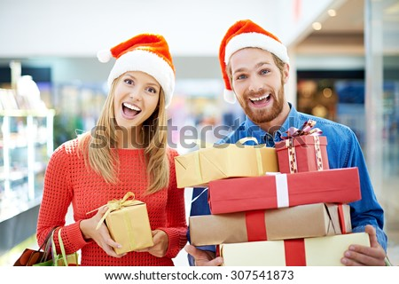 Joyful couple going shopping for Christmas