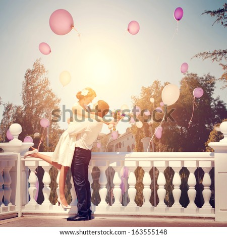 Joyful emotional meeting the happy couple man and woman outdoor in a retro style - stock photo