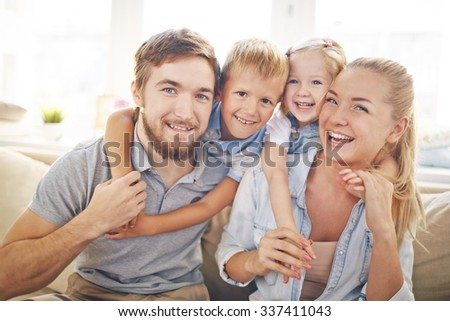 Joyful family having nice time at home