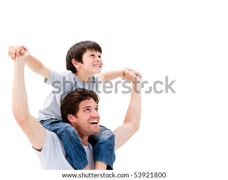 Joyful father giving piggyback ride to his son against a white background - stock photo
