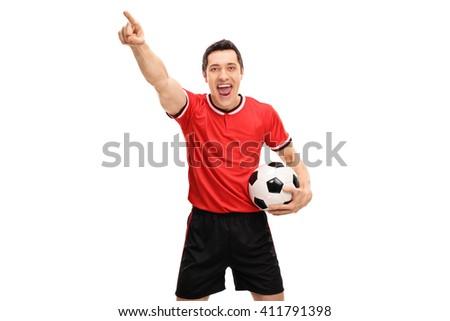 Joyful football player celebrating something and looking at the camera isolated on white background - stock photo