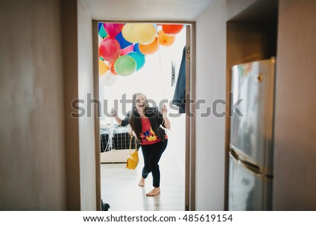 Joyful friend with the colorful balloons