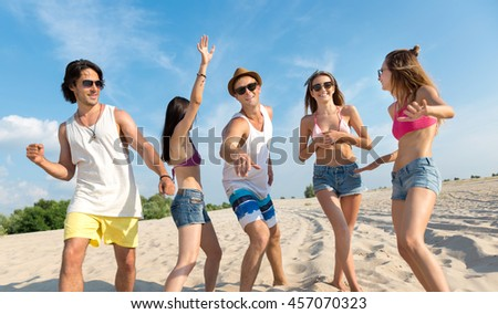 Joyful friends having fun on the beach
