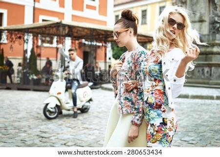 Joyful friends spending leisure time in downtown - stock photo