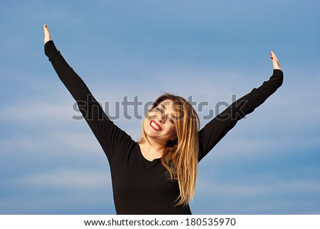 Joyful Girl A happy girl jumping for joy.  - stock photo
