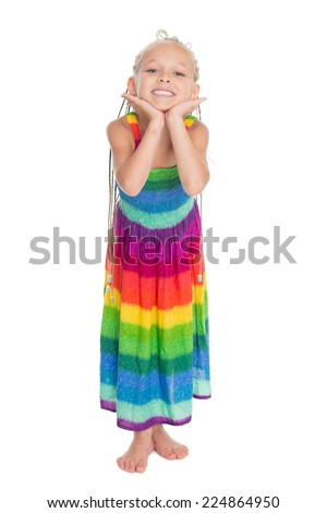 Joyful girl in a colorful summer dress. Girl is six years old.  - stock photo