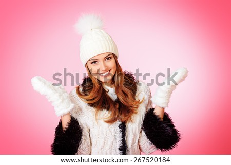 Joyful girl in warm knitted clothing smiling at camera. Beauty, fashion. Winter lifestyle.