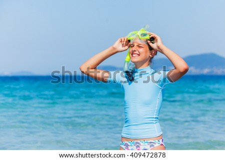 Joyful girl in yellow mask going scuba diving.