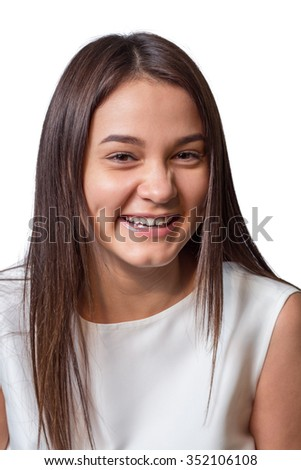 Joyful girl laughs on a white background