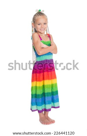 Joyful girl with crossed hands in full growth. The girl is six years old. - stock photo