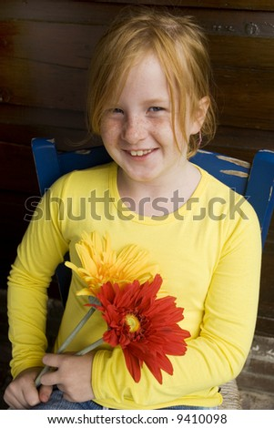 joyful girl with flowers and freckles - stock photo