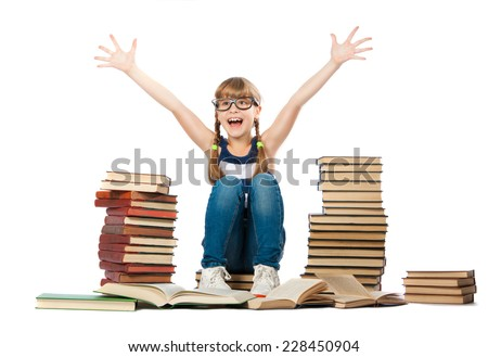 Joyful girl with piles of books