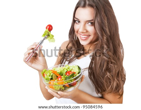 joyful girl with salad on white background - stock photo