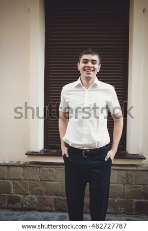 Joyful handsome man in the white shirt