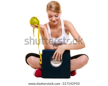 Joyful happy woman girl holds holding grapefruit, measurement tape and weighing scale. Fitness and healthy lifestyle concept. Dieting and slimming. Isolated on white background. - stock photo
