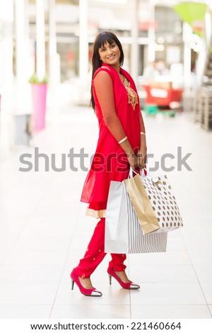 joyful indian girl in shopping center - stock photo