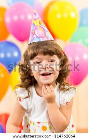 joyful kid girl on birthday party - stock photo