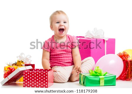 Joyful kid girl with colorful gifts. Isolated on white. - stock photo