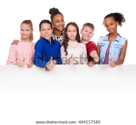 joyful kids with thumbs up holding an empty blank
