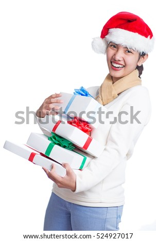 Joyful lady carrying a bunch of gift boxes. Isolated in white background.