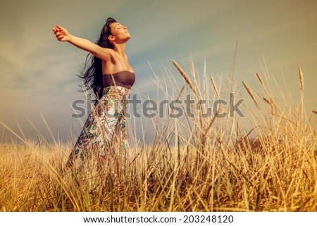 joyful life outdoor field on coast - stock photo