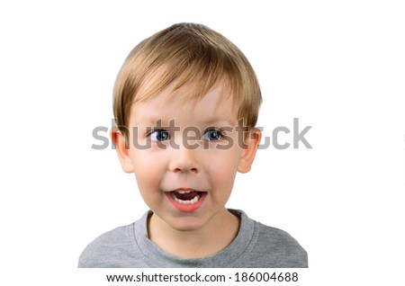 joyful little boy looking away. isolated on white background, horizontal