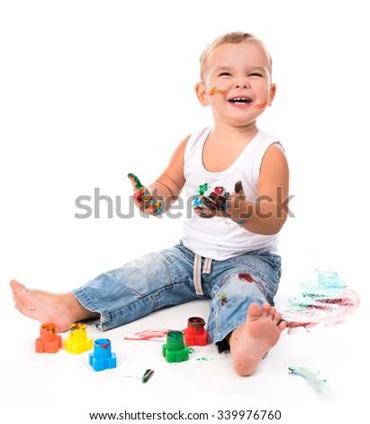 joyful little boy with paints isolated on white background - stock photo