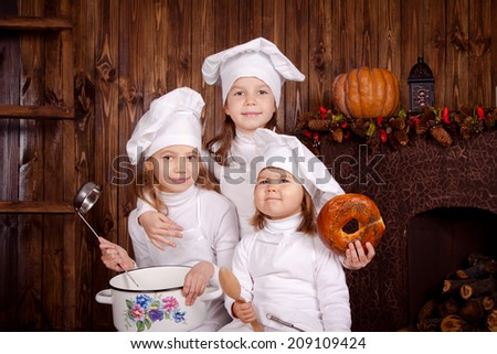 Joyful little chef, cook children - stock photo